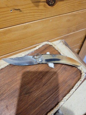 Couteau plient cran d'arrêt